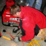 Journeyman electrician working